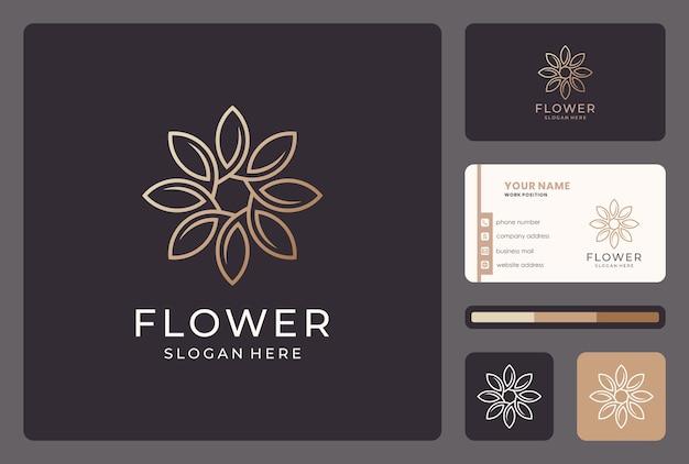 Création de logo de fleur ligne abstraite dorée avec carte de visite.