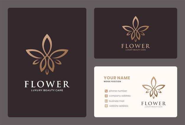 Création de logo de fleur de luxe avec modèle de carte de visite.