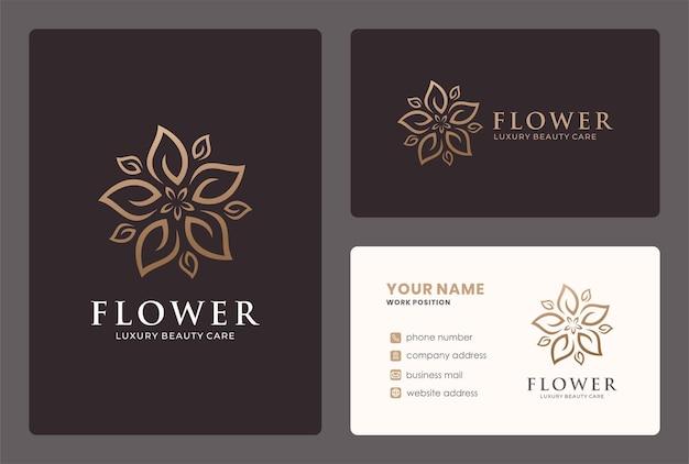 Création de logo de fleur de luxe avec un ornement de feuille en forme de cercle.