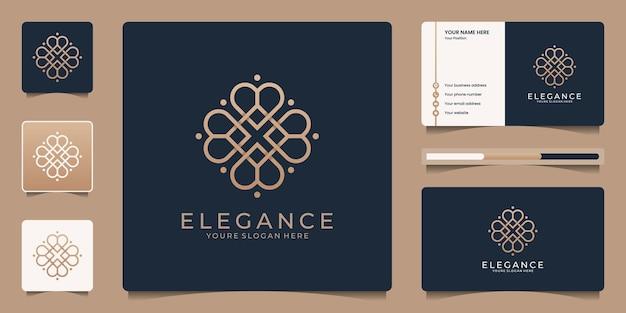 Création de logo de fleur d'or abstrait de luxe avec modèle de carte de visite.