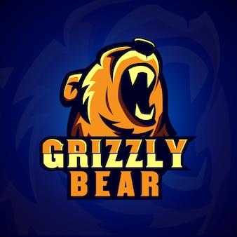 Création de logo de jeu grizzly bear e sport avec couleur dorée