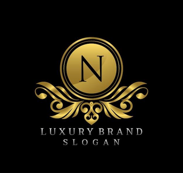 Création de logo de luxe élégant or bagde lettre n