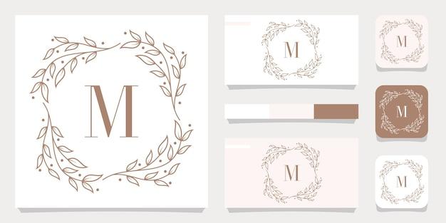 Création de logo de luxe lettre m avec modèle de cadre floral, conception de carte de visite