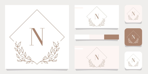 Création de logo de luxe lettre n avec modèle de cadre floral, conception de carte de visite