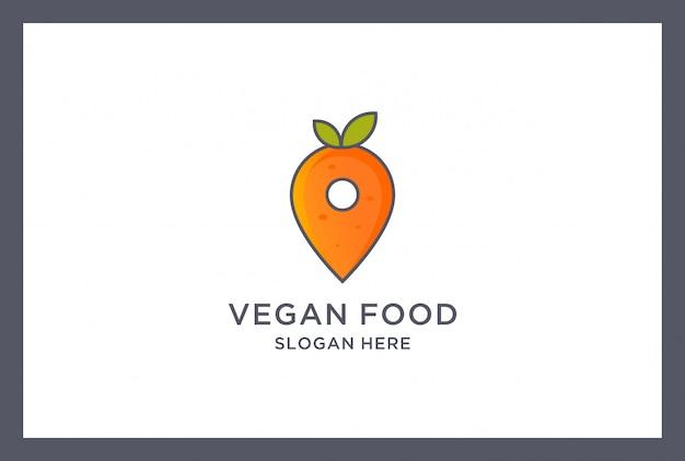 Création de logo de nourriture végétalienne. emplacement de la broche de carotte