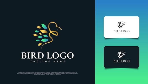 Création de logo d'oiseau de luxe en bleu et or
