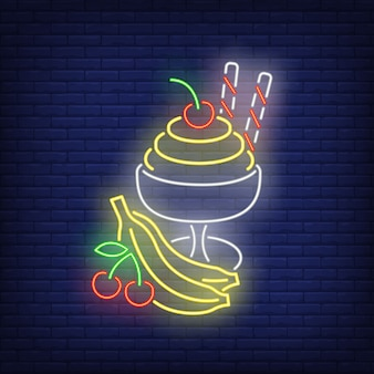 Crème glacée avec une enseigne au néon de fruits.