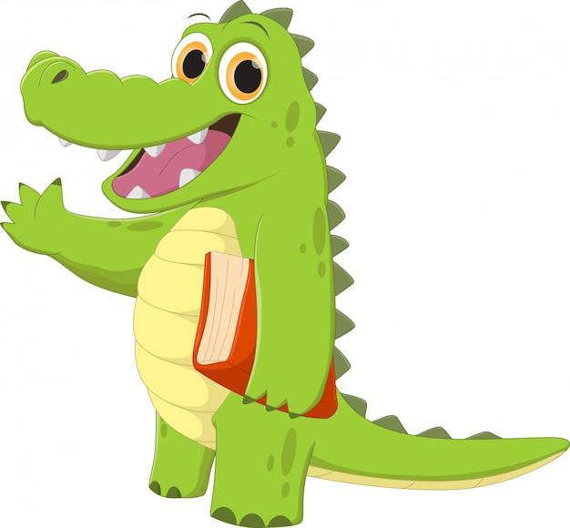 Crocodile de dessin animé heureux agitant avec un livre