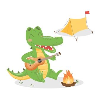 Crocodile jouant de la guitare et chantant près du feu. camping alligator avec tente et feu.