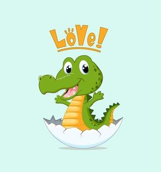 Crocodile nouveau-né mignon dans la coquille d'oeuf.