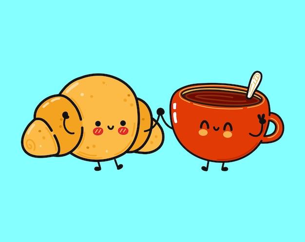 Croissant heureux drôle mignon et tasse de caractère de café