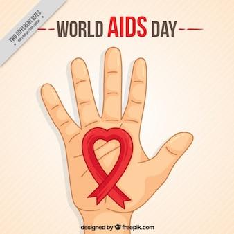 Croquis fond de la main avec un ruban rouge de la journée mondiale contre le sida