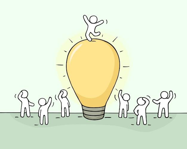 Croquis de l'idée de la lampe avec une foule de petites personnes.