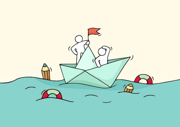 Croquis de travail de petites personnes avec bateau en papier.