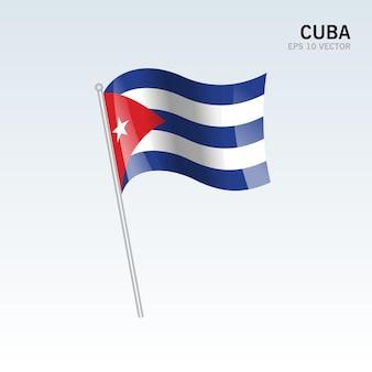 Cuba agitant le drapeau isolé sur fond gris