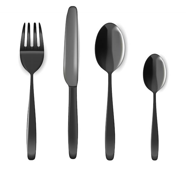 Cuillère noire réaliste, fourchette et couteau sur la table à manger