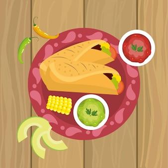 Cuisine mexicaine avec sauce épicée et épi
