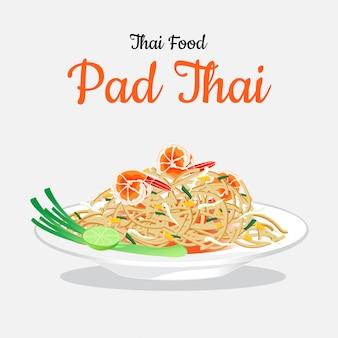Cuisine thaïlandaise pad thai sur un plat blanc.