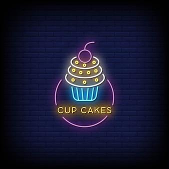 Cup cakes enseignes au néon sur mur sombre