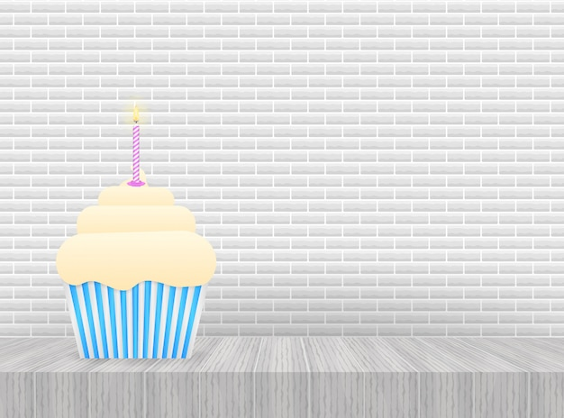 Cupcake au chocolat avec bougie allumée.