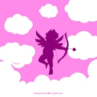 Cupidon silhouette sur fond nuageux rose