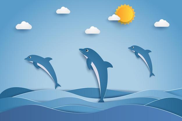 Dauphins heureux sautant dans les vagues de la mer dans un style art papier