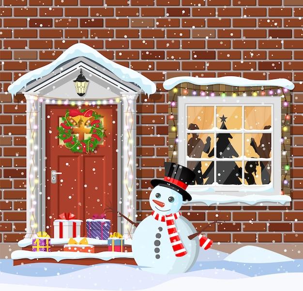 Décoration de porte de maison pour noël