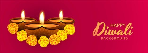 Décoré avec des lampes à huile illuminées fond de bannière de célébration de diwali