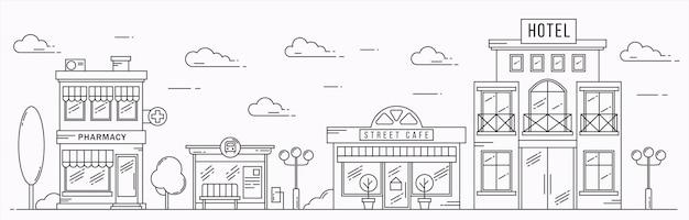 Décrire la rue avec des maisons et des nuages café pharmacie hôtel et arrêt de bus paysage