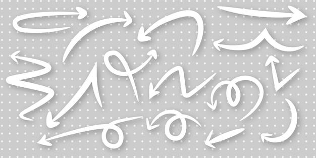 Définir la conception de modèle de flèche dessinée à la main créative