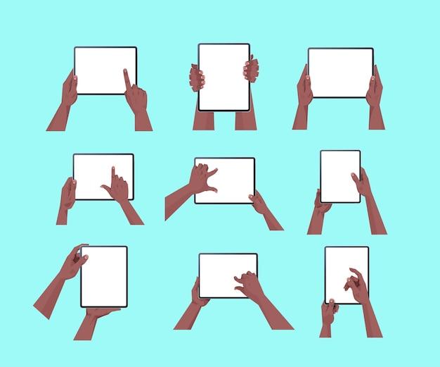 Définir des mains humaines afro-américaines tenant tablet pc avec écran tactile blanc à l'aide d'un appareil numérique