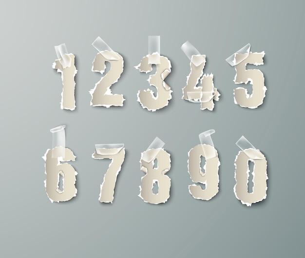Définissez des nombres à partir de papier déchiré avec du ruban adhésif transparent.
