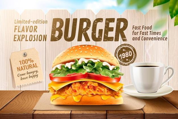 Délicieux hamburger de poulet frit avec café sur table en bois et clôture blanche