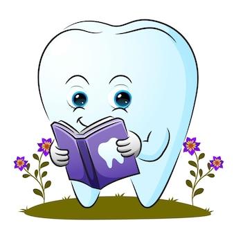 La dent intelligente lit un livre sur l'illustration dentaire