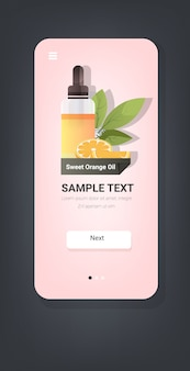 Déposer une bouteille en verre d'huile essentielle d'orange douce avec des fruits et des feuilles d'orange visage naturel remèdes de beauté du corps concept smartphone écran application mobile vertical