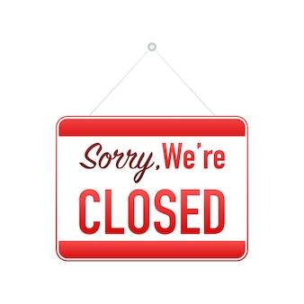 Désolé, nous sommes fermés signe suspendu sur fond blanc