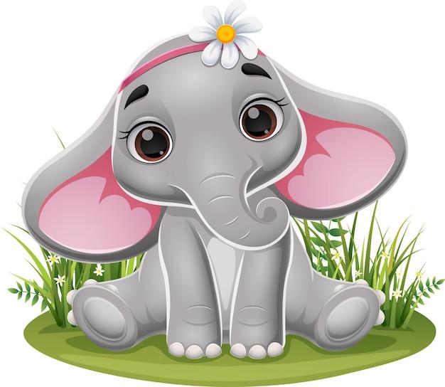 Dessin animé bébé éléphant assis dans l'herbe