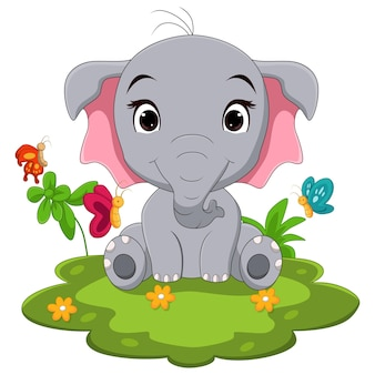 Dessin animé bébé éléphant assis sur l'herbe