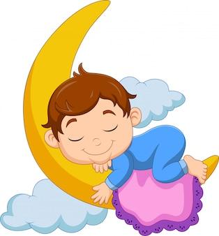 Dessin animé bébé garçon dormant sur la lune
