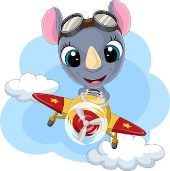 Dessin animé bébé rhinocéros équitation fusée