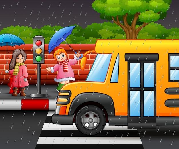 Dessin animé deux fille portant un parapluie