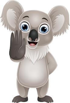 Dessin animé drôle koala montrant le geste d'arrêt