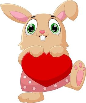 Dessin animé drôle de lapin tenant coeur amour