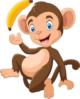 Dessin animé drôle de singe tenant la banane
