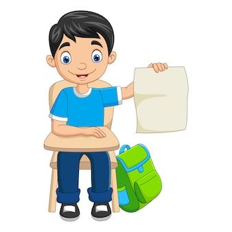 Dessin animé garçon étudiant tenant un papier vierge