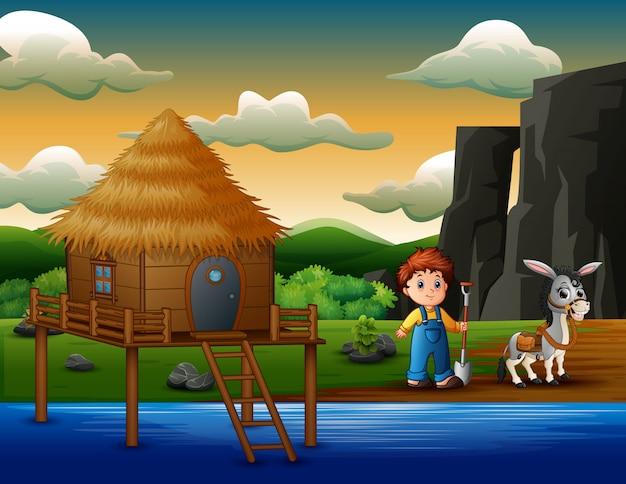 Dessin animé garçon fermier avec âne au bord de la rivière