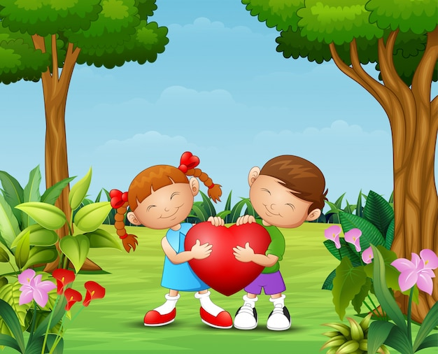 Dessin animé heureux couple enfant tenant un coeur dans le parc