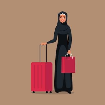 Dessin animé jeune femme arabe se tient avec des bagages pour voyager. isolé du fond