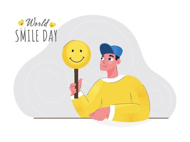 Dessin animé jeune homme tenant un bâton smiley sur fond blanc et gris pour la journée mondiale du sourire.