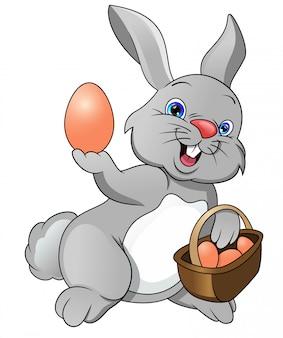 Dessin animé joyeux lapin et oeuf